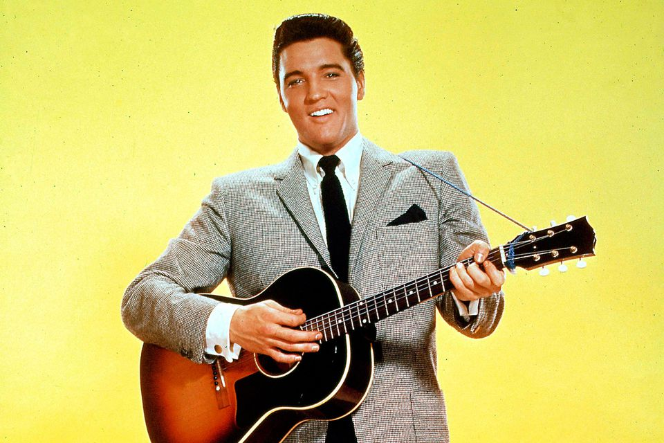 a look into the life and music career of elvis aaron presley Elvis aaron presley as his music reached into the living rooms where television bow down to the king of music elvis presley paul turner.